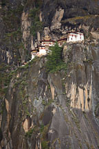 Taktshang Goemba (Tiger's Nest) monastery is build on a cliff face high above the valley floor. Paro Valley, Bhutan. - Photo #24297