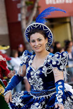 Woman wearing blue dress with silver embroidery. Carnaval's grand parade. San Francisco, California, USA. - Photo #6197