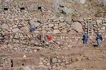Workers restoring ruins at Patallaqta. Inca trail, Peru. - Photo #9697