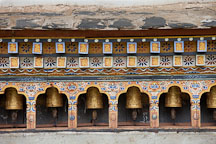 Prayer wheels at the Temple of the Divine Madman. Lobesa Valley, Bhutan. - Photo #23598