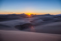 The sun sets behind the dunes. Great Sand Dunes NP, Colorado. - Photo #33199