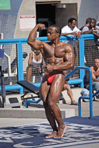 Bodybuilder posing in competition at Muscle beach, Venice, California, USA. - Photo #8648